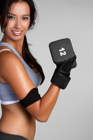 Fit exercising woman lifting weights Stock Photo