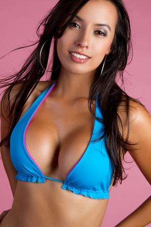 latin ethnicity: Smiling girl wearing blue bikini LANG_EVOIMAGES