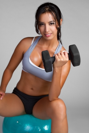 girl fitness: Happy young fitness woman exercising LANG_EVOIMAGES