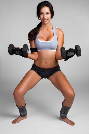 Healthy fitness woman lifting weights Stock Photo - 9397213