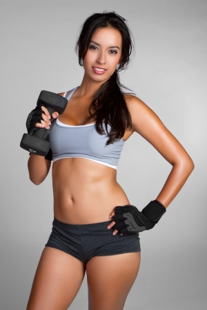 Hispanic fitness woman lifting weights LANG_EVOIMAGES