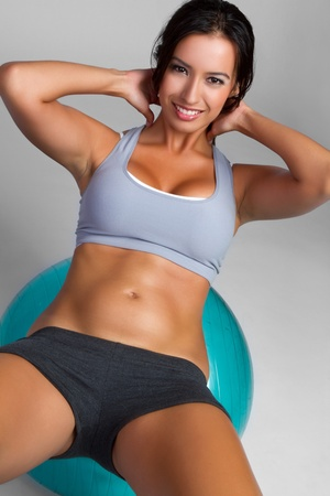 Smiling beautiful young woman exercising photo