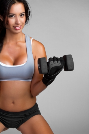 heavy lifting: Hispanic fitness woman lifting weights LANG_EVOIMAGES