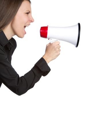 loud: Young woman yelling into megaphone
