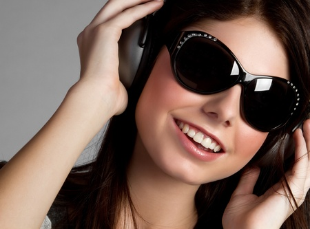 Headphones music girl wearing sunglasses photo
