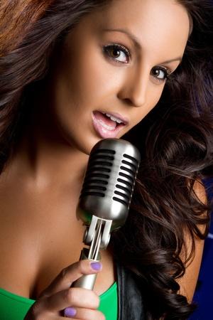 Beautiful vintage microphone girl singing Stock Photo - 9466103