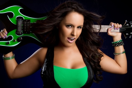 rockstar: Sexy girl holding electric guitar