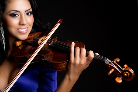 Beautiful smiling woman playing violin Stock Photo - 9466106