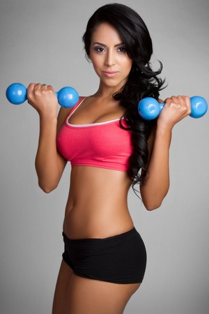 Beautiful fit latin woman exercising Stock Photo