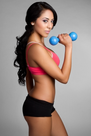 Healthy fit latin woman exercising