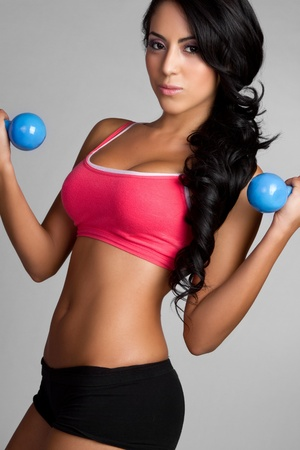 Beautiful young latin woman exercising Stock Photo - 9466137