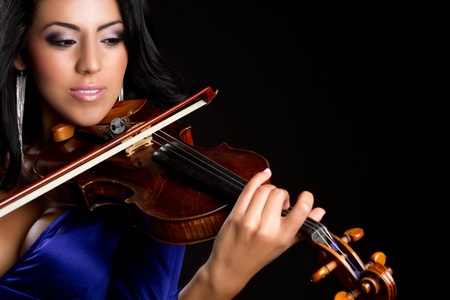performers: Beautiful young woman playing violin