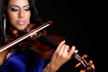 performing: Beautiful young woman playing violin