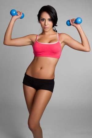 Pretty fit latin woman exercising Stock Photo - 9466127