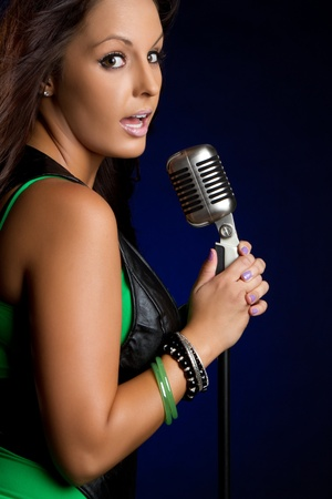 Beautiful young woman singing karaoke Stock Photo - 9466128