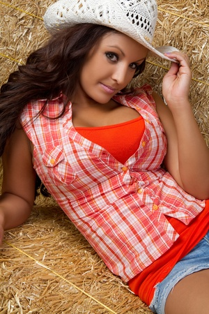 Pretty country girl in hay Stock Photo - 9466143
