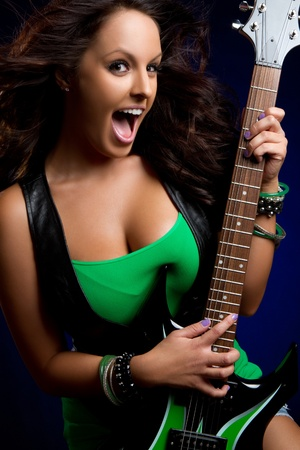 girl playing guitar: Beautiful girl playing electric guitar