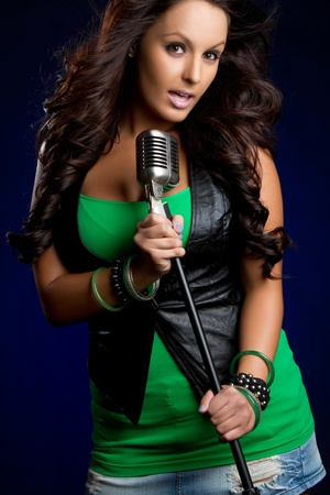 Beautiful young female microphone singer Banco de Imagens