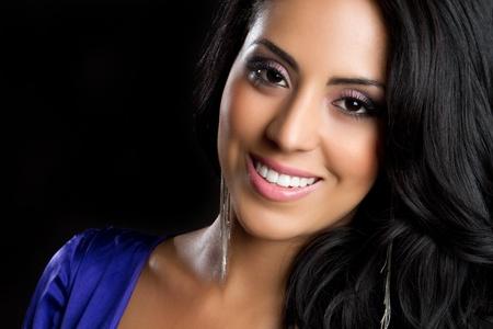 Beautiful young smiling hispanic woman Stock Photo - 9475857