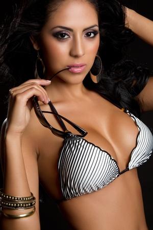 Beautiful swimsuit woman holding sunglasses Stock Photo - 9475860
