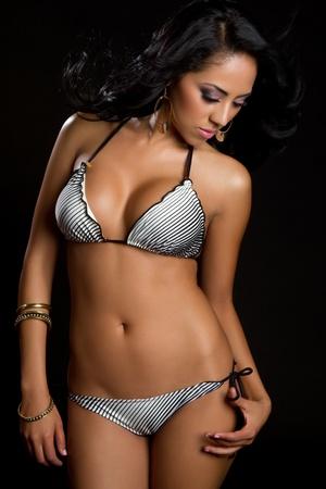 Beautiful hispanic bikini swimwear woman LANG_EVOIMAGES
