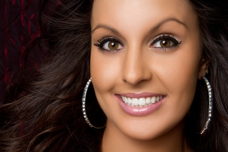 Pretty young brunette woman smiling photo