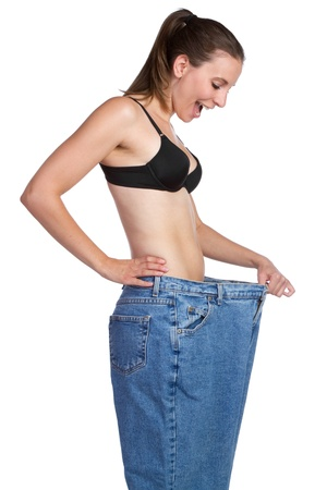 Weight loss girl holding pants