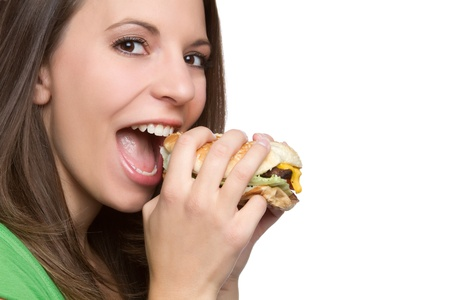 adult sandwich: Beautiful young woman eating hamburger LANG_EVOIMAGES