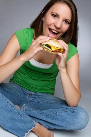 adult sandwich: Pretty girl eating burger food