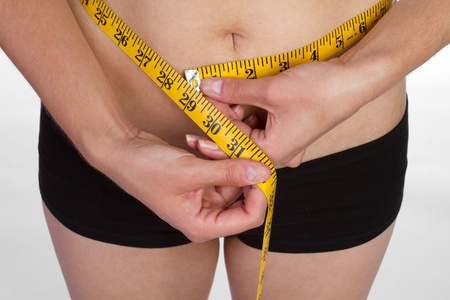 Weight loss woman measuring waist Stock Photo