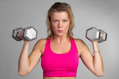 Middle aged fitness woman exercising Imagens