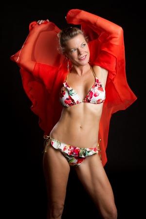 Middle aged woman wearing bikini