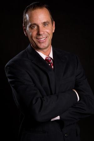 Handsome middle aged smiling businessman