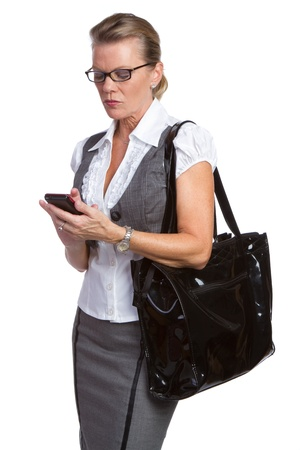 Older businesswoman using cell phone photo