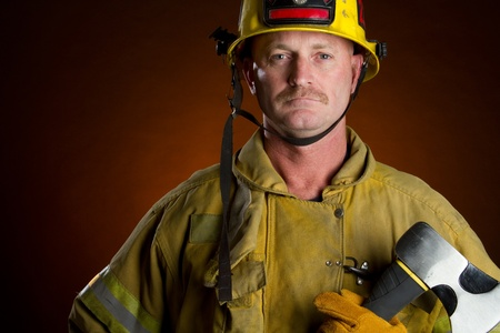 fire safety: Firefighter fireman man holding axe