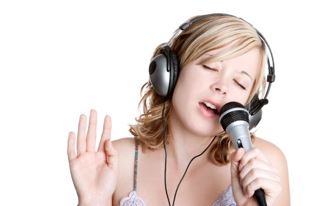Beautiful blond singing music girl Stock Photo - 10435400