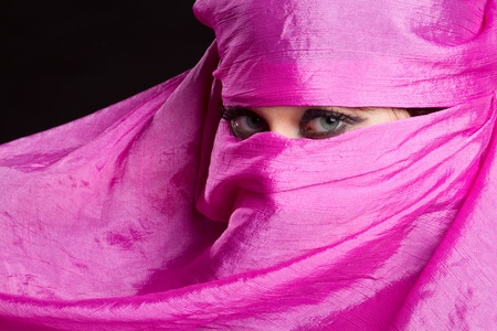 middle eastern ethnicity: Arabian woman wearing pink headscarf