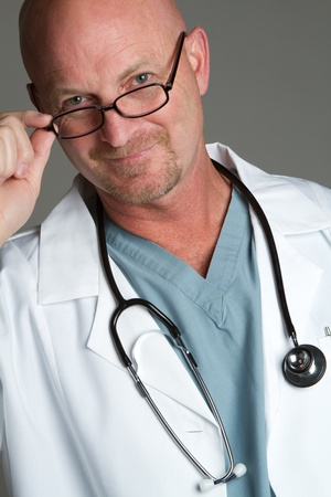 Handsome smiling doctor wearing glasses photo