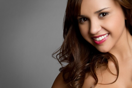Beautiful young hispanic girl smiling