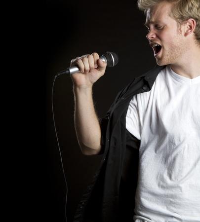 kareoke: Young man singing microphone karaoke