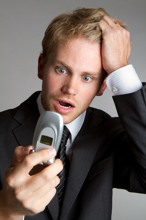 Frustrated shocked phone business man photo