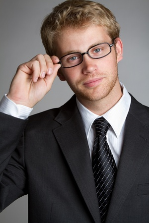 Handsome young businessman wearing glasses photo