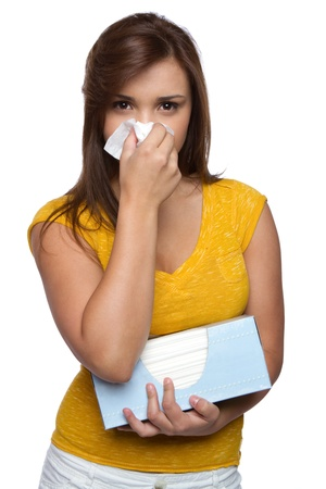 Isolated sick girl blowing nose Stock Photo