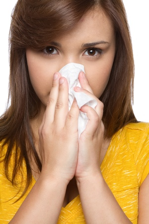 Pretty hispanic girl blowing nose Stock Photo