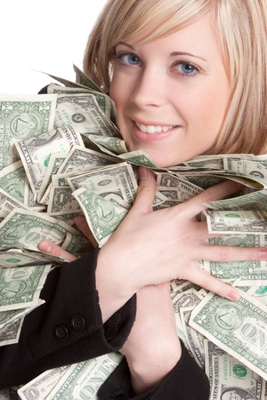 Smiling beautiful woman holding money photo