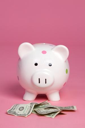 Money pig on pink background Stock Photo - 11129160