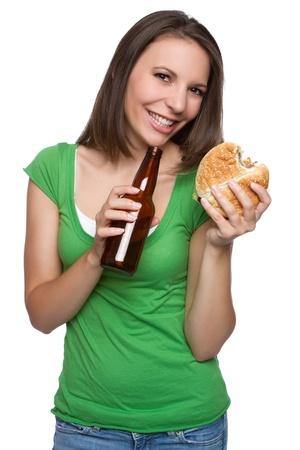 Girl eating burger drinking beer Stock Photo - 11147861