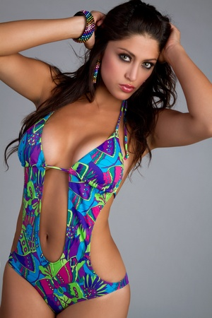 one piece swimsuit: Sexy hispanic woman wearing swimsuit LANG_EVOIMAGES