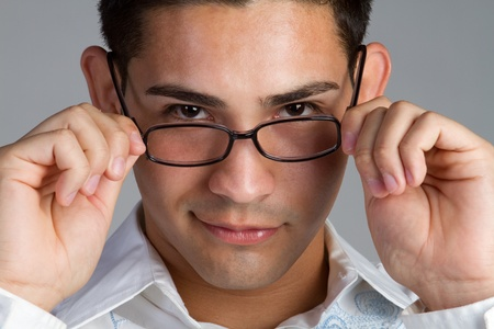 hispanics mexicans: Young hispanic man wearing glasses