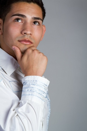 Young hispanic man thinking Stock Photo - 11215870